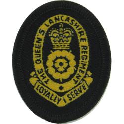Queen's Lancashire Regiment (All Yellow) On Black Oval with Queen Elizabeth's Crown. Woven Other Ranks' cap badge