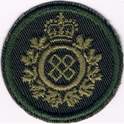 Canadian Armed Forces Logistics Branch Green Bush Hat Badge with Queen Elizabeth's Crown. Embroidered Other Ranks' cap badge