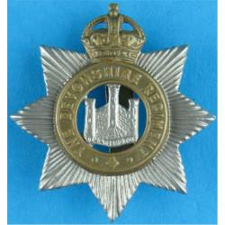 Devonshire Regiment  with King's Crown. Bi-metallic Other Ranks' metal cap badge