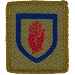 Royal Artillery: 102 (Ulster) Air Defence Regiment Red Hand In Shield  Woven Regimental cloth arm badge