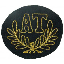 AT In Wreath (Anti-Tank Gunner: Royal Green Jackets) Black/Gold On Green  Bullion wire-embroidered Army cloth trade badge