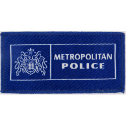 Metropolitan Police Pullover Badge Mid-Blue Rectangle with Queen Elizabeth's Crown. Woven UK Police or Prison insignia