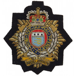 Royal Logistic Corps On Navy Blue Backing with Queen Elizabeth's Crown. Bullion wire-embroidered Officers' cap badge