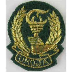 Tanzania Peoples' Defence Force Umoja - On Green  Mylar Officers' cap badge