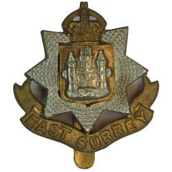 East Surrey Regiment  with King's Crown. Bi-metallic Other Ranks' metal cap badge