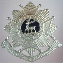 Bedfordshire & Hertfordshire Regiment FL - Blue Centre  Silver-plated and enamel Officers' collar badge